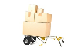 Heap or stack of brown carton transport boxes with barrow over white background, delivery, freight or transportation industry concept