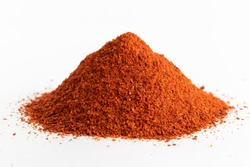 Heap red chili powder or paprika on a white background