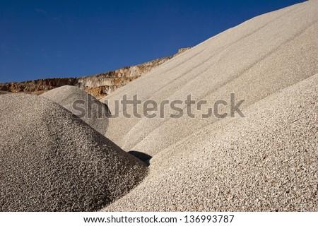 Heaps of aggregate in a rock quarry near Split in croatia