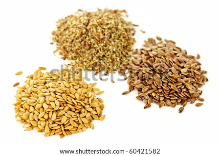 Heaps of brown, golden and ground flax seed or linseed isolated on white background - stock photo