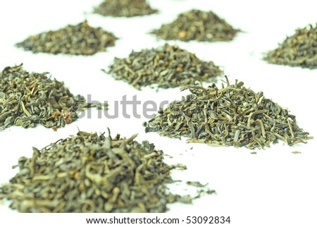 Heaps of flavored green tea isolated on white background
