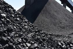 Heaps of industrial coal. Coal mine, coal storage.
