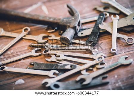 Heaps Of Old Wrench Tools On Old Wooden Table In Wood Workshop Ez