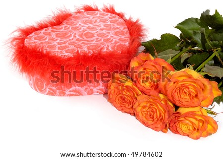 Hear shaped gift box and bunch of orange roses isolated on white background