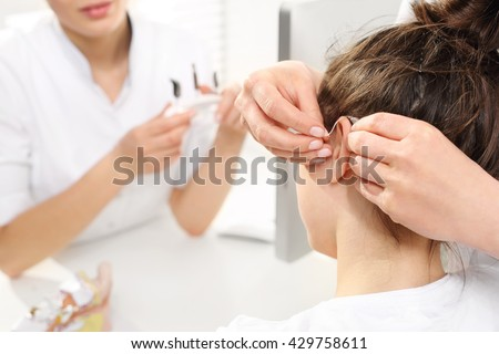 Hearing loss in children. Mom with a child in laryngologist. A child at the ENT doctor.