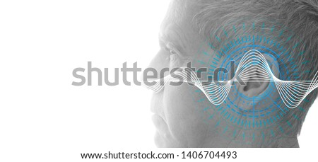 Hearing test showing ear of senior man with sound waves simulation technology - isolated on white banner