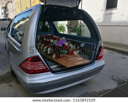 hearse with flowers