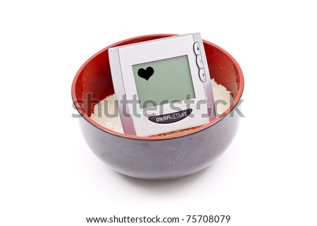 Heart and Blood Pressure Monitor on Bowl of Plain Rice