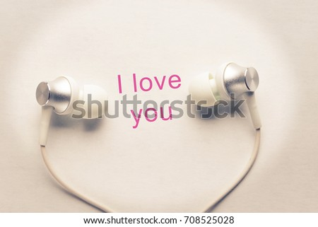 heart and headphones. listen to love songs concept #708525028
