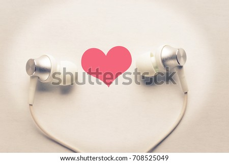 heart and headphones. listen to love songs concept #708525049