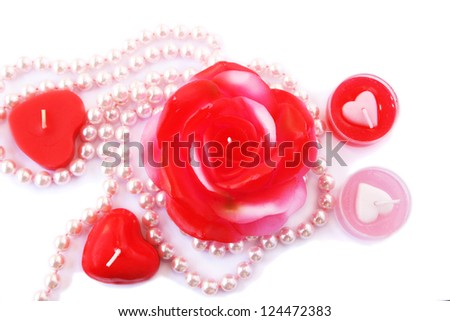 Heart and rose shape red candles, necklace isolated on white background. - stock photo