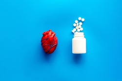 Heart and treatment. Heart near pills tonometer, treatment  on blue background top view