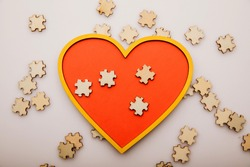 Heart and wooden puzzles. Healthcare concept