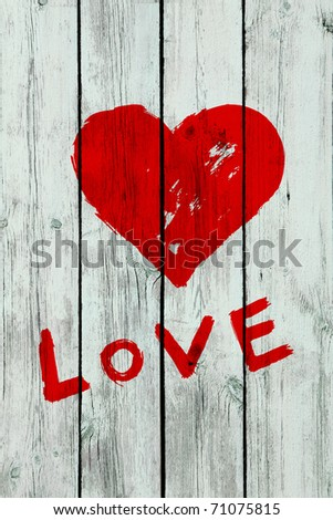 heart and word ''love'' on wooden wall