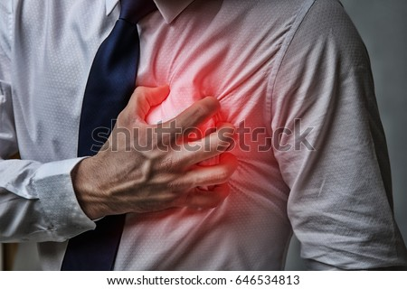 Heart attack concept. Man suffering from chest pain, closeup #646534813