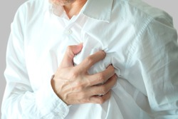 Heart attack, Man standing chest pain in the bedroom Health concept.