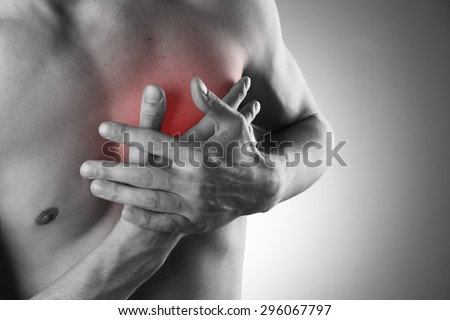 Heart attack. Pain in the human body.  Black and white photo with red dot