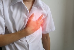 Heart attack symptom. Man clutching his chest from refer pain of myocardial infarction. Man with chest pain suffering from heart attack. Acute myocardial infarction concept. Medical concept.
