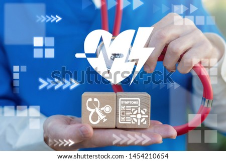 Heart Attack Symptoms Medical First Aid concept. Doctor uses stethoscope touches heart pulse and flash lightning icon and holds two wooden cubes with cardiac icons. #1454210654