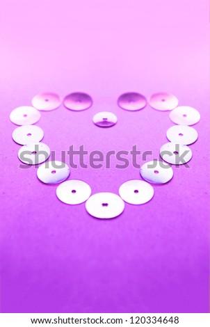 Heart background from small shiny circles