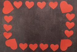 Heart Border, Valentine's Day, Love Border, Red Heart Border Background, Valentine's Day Card Background. Red heart border on a black background, in the middle space for your text. Top view flat lay.