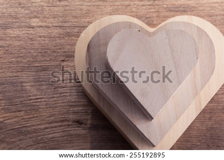 heart brown wood box on wood background, abstract love background