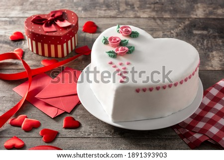 Heart cake for St. Valentine's Day, Mother's Day, or Birthday, decorated with roses and pink sugar hearts on wooden table Photo stock ©