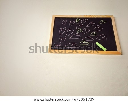 Heart cartoon shape draw by colorful chalk on blackboard. For student,teacher or who want tell love someone. #675851989