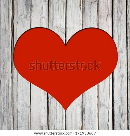 Heart carved on a wooden surface. The concept of Valentine's Day