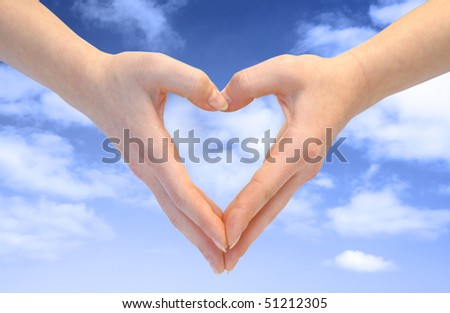 Heart combined from hands on blue background