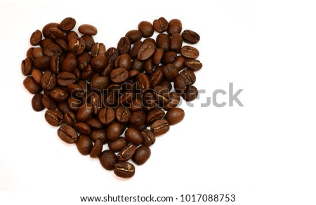 Photo of Heart consisting of coffee beans isolated on white background. Love of coffee. Image with free space for text.