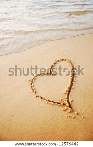heart drawing in the sand beach