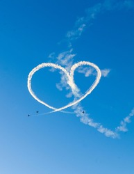 Heart drawn in the sky with airplane