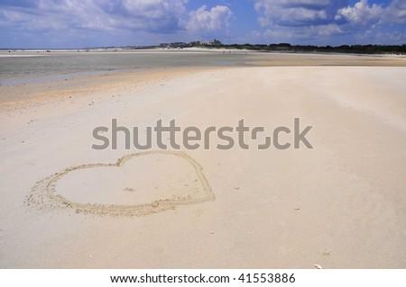 heart drawn on pretty beach scape