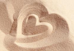 Heart drawn on sand
