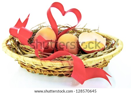 Heart,egg sell,egg yolk,red tape,isolated on a white background.