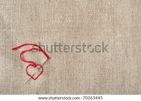 heart embroidered on natural linen canvas