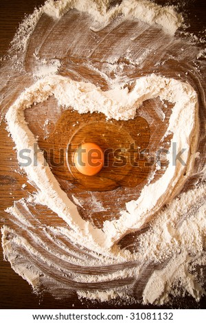 Heart formed of flour with an egg inside.