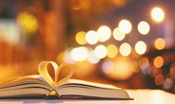 Heart from a book page vintage style close up heart shape from paper book with bokeh in soft light at night ,(blur background) ,copy space,concept for valentine's da