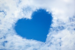 Heart from cloud in the blue sky. Valentine's Day. Symbol of love