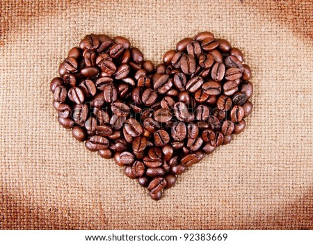 heart from coffee beans on sacking