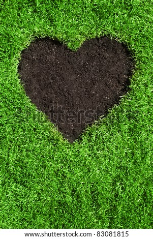 heart from soil inside of green grass