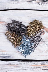 Heart from various screws and nails.
