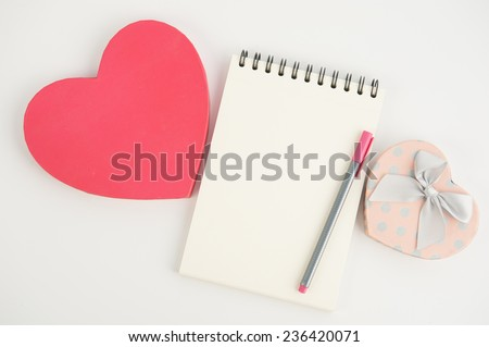 Heart gift box and note book pen on  white background