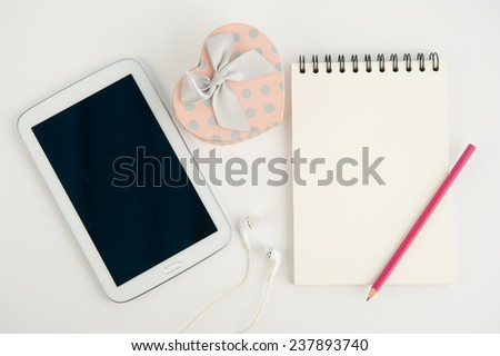 Heart gift box tablet and note book pen on white background