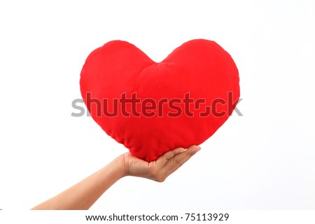 Heart in a female hand isolated on white background