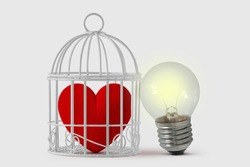 Heart in bird cage with free light bulb - Mind and heart concept