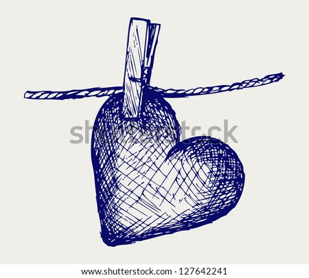 Heart in clothesline. Doodle style. Raster version