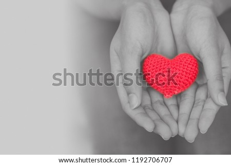 heart in girl hand for giving share love to other concept with copy space #1192706707