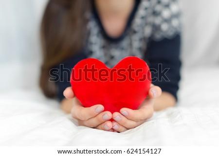 Heart in hands #624154127